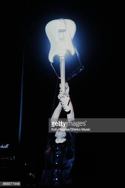 Rainbow Ritchie Blackmore holding guitar high at Nippon Budokan Tokyo May 8 1980