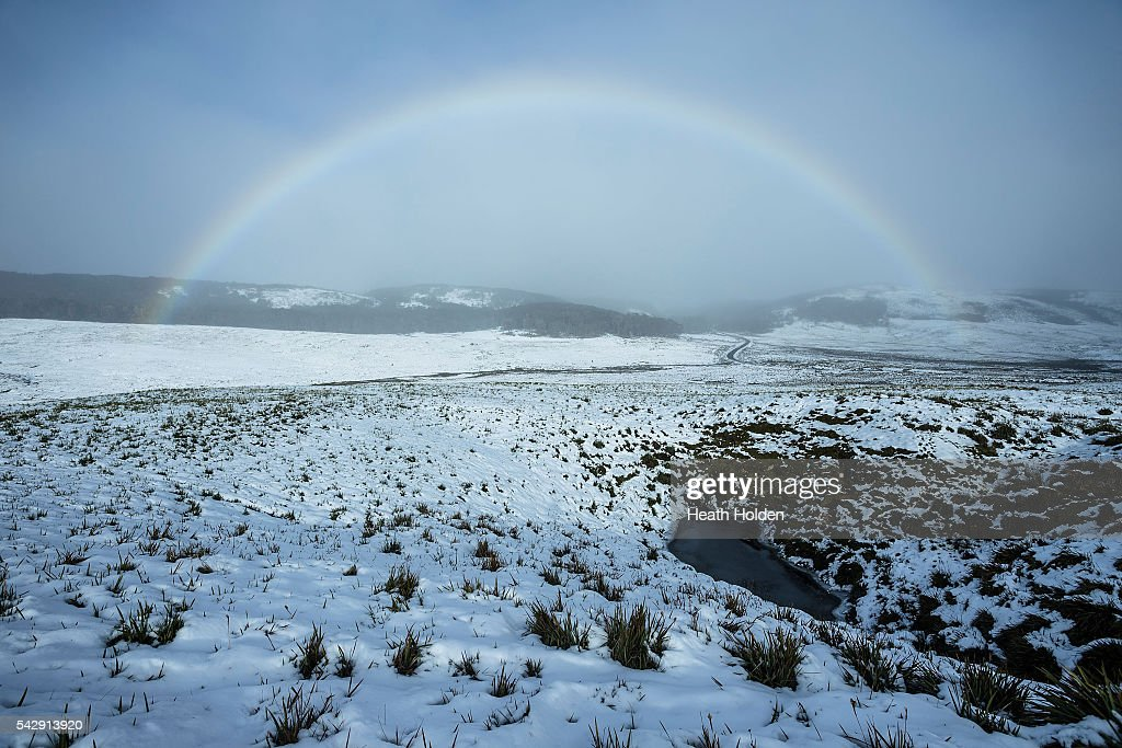 A rainbow sits above the fresh snowfall blanketing the highlands on June 25, 2016 in Cradle Mountain, Australia. Snow has been forecast across Eastern Australia as cold front continues to bring low temperatures, rain and potentially damaging winds.