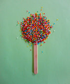 A sweet popsicle made of rainbow sprinkles
