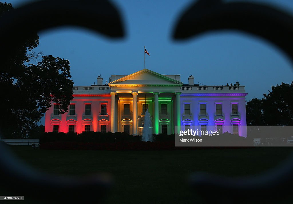 Rainbowcolored lights shine on the White House to celebrate today's US Supreme Court ruling in favor of samesex marriage June 26 2015 in Washington...