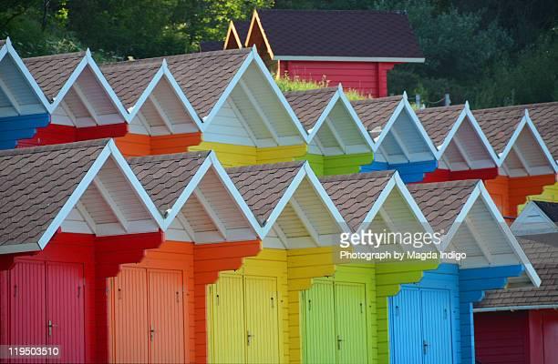 Rainbow-coloured beach-huts