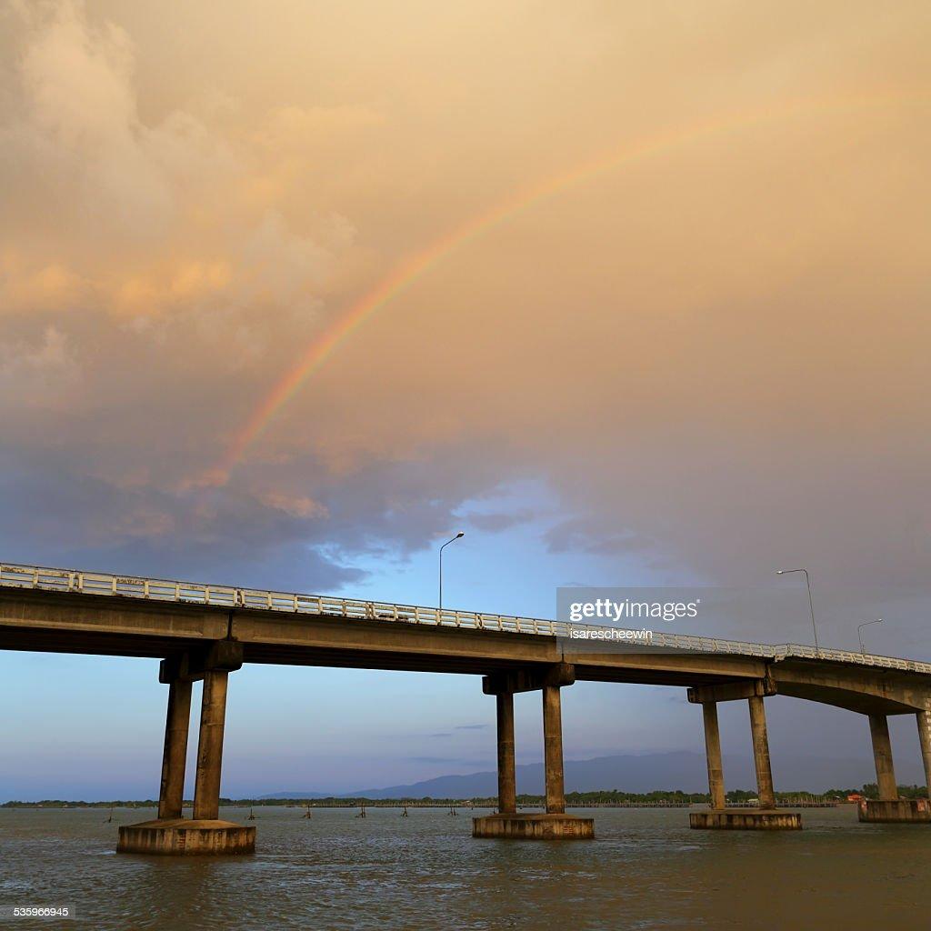 Rainbows over bridge cross : Stock Photo