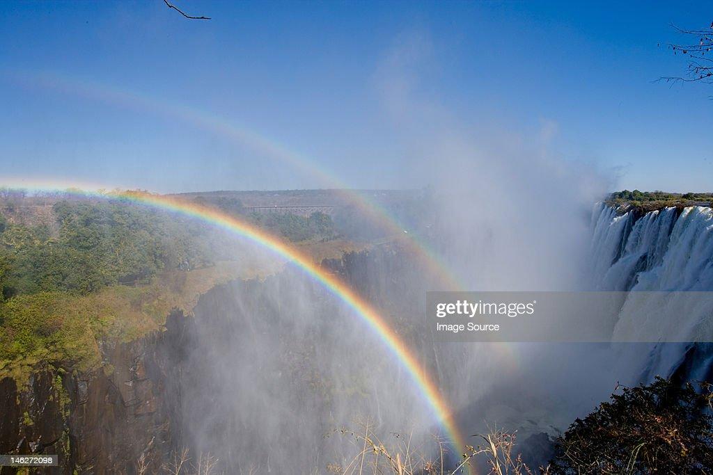 Rainbows over Victoria Falls : Stock Photo