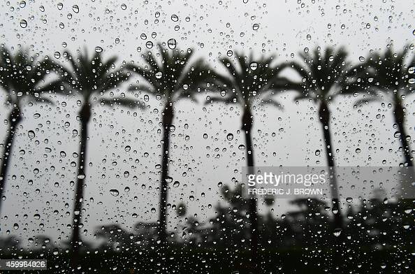 Raindrops are seen on a vehicle's window in Arcadia California on December 2 amid a steady and sometimes heavy rainfall soaking southern California...