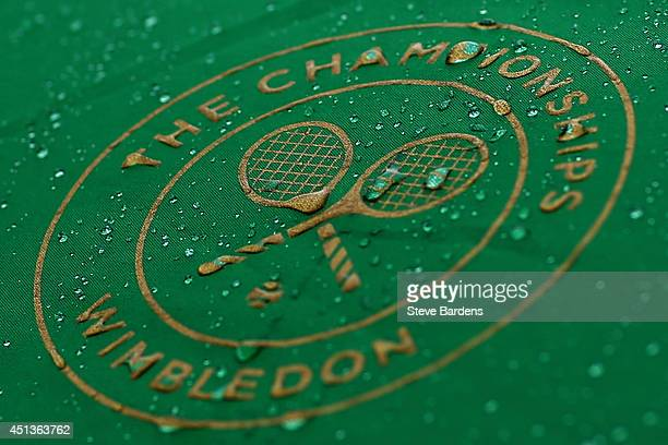 Raindrops are seen on the Wimbledon logo on day six of the Wimbledon Lawn Tennis Championships at the All England Lawn Tennis and Croquet Club at...