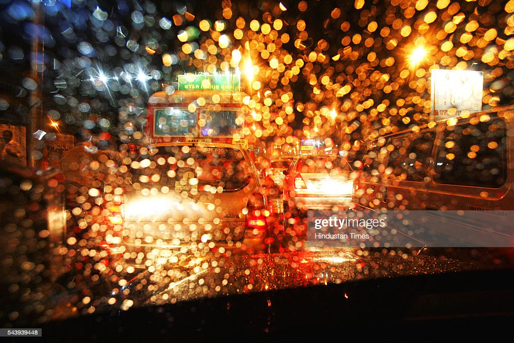 Raindrops glisten on the windshield of a Cab while hapless commuters wait for the traffic to move at Mahim Causeway on Wednesday on July 20, 2005 in Mumbai, India. Like every year heavy rains are the cause of a number of traffic jams at major intersections around the city.