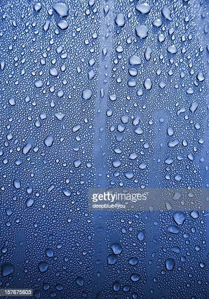 Raindrops on blue metall background