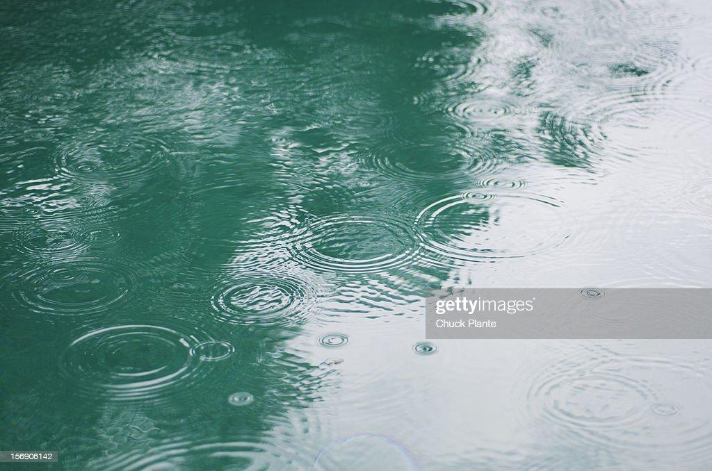 Raindrops On Puddle : Stock Photo