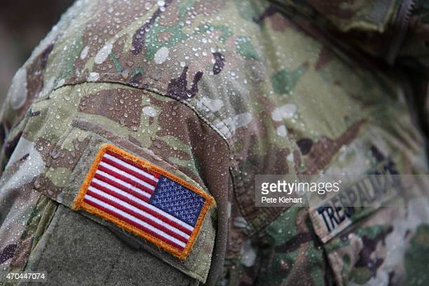 Raindrops on the jacket of a member of the 173rd Airborne during the opening ceremony for Operation Fearless Guardian on April 20 2015 at the...