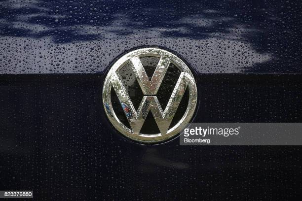 Raindrops rest on the badge of a used Volkswagen Golf automobile outside a Volkswagen AG showroom in Berlin Germany on Wednesday July 26 2017...