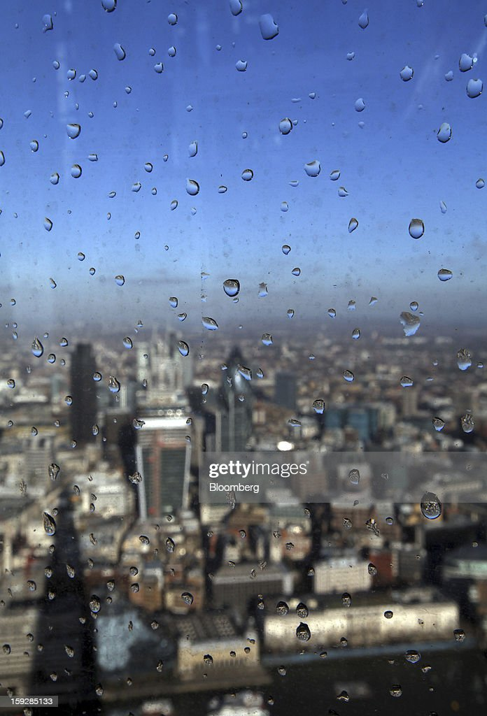 Raindrops sits on a window at 'The View From The Shard', a series of viewing galleries looking over the City of London, near the top of the Shard tower in London, U.K., on Wednesday, Jan. 9, 2013. The Shard, which stands at 309.6 meters on London's South Bank, is owned by LBQ Ltd., which brings together the State of Qatar (the majority shareholder) and Sellar Property Group Ltd., with non-equity funding by Qatar National Bank. Photographer: Chris Ratcliffe/Bloomberg via Getty Images