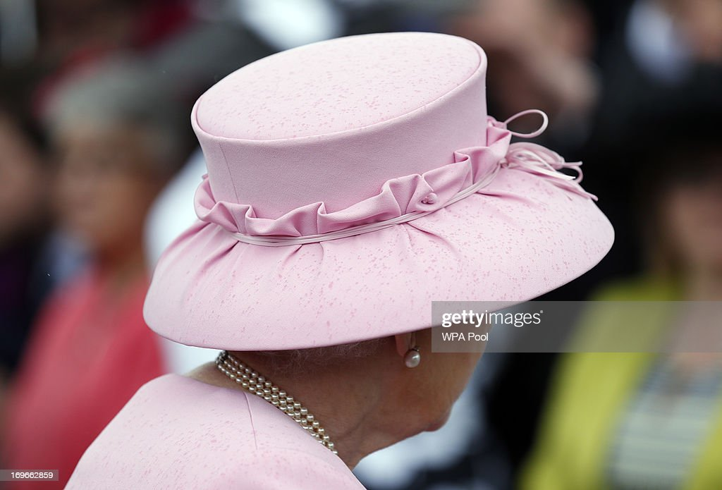 Raindrops speckle the hat of Queen <a gi-track='captionPersonalityLinkClicked' href=/galleries/search?phrase=Elizabeth+II&family=editorial&specificpeople=67226 ng-click='$event.stopPropagation()'>Elizabeth II</a> during a garden party held at Buckingham Palace, on May 30, 2013 in London, England.