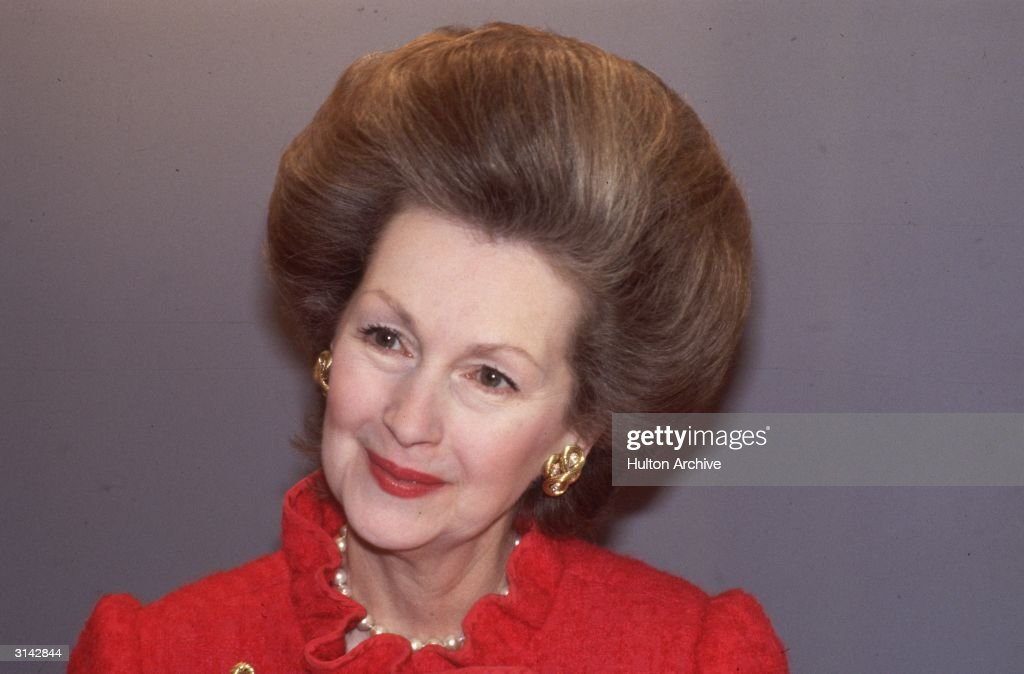 Raine, Countess Spencer with a bouffant hair do. She is the step-mother of Diana, Princess of Wales and daughter of novelist Barbara Cartland.