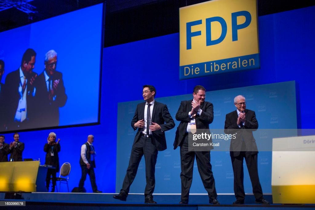 Rainer Bruederle (R), Bundestag faction leader of the German Free Democrats, and Patrick Doering (C), general secretary of the Free Democratic Party (FDP), applaud Philipp Roesler (L), German Economy Minister and Chairman of the German Free Democrats (FDP) political party, after his speach to delegates at the FDP federal convention on March 9, 2013 in Berlin, Germany. The FDP, the junior partner in the current German government coalition, is struggling to attract supporters in the wake of a sharp decline in its popularity. Germany is scheduled to face national elections in September.