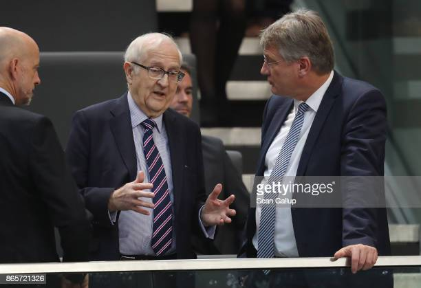 Rainer Bruederle of the German Free Democratic Party and Joerg Meuthen of the rightwing Alternative for Germany attend the opening session of the new...