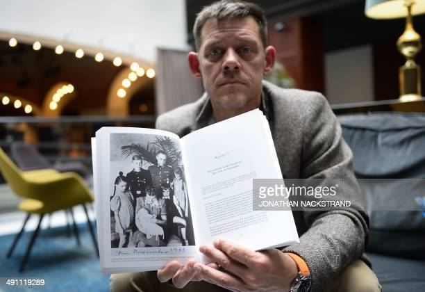 FAU Rainer Hoess the grandson of Rudolf Hoess the Nazi commandant of the Auschwitz concentration and extermination camp shows a picture in his book...