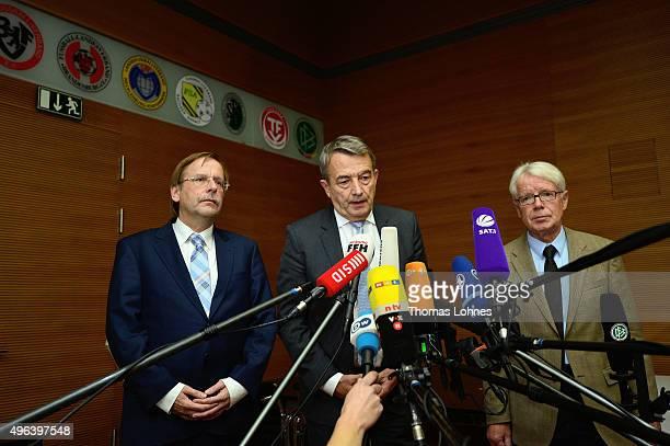 Rainer Koch vicepresident of German Football Association Wolfgang Niersbach and Reinhard Rauball president of the German Football League speak to the...
