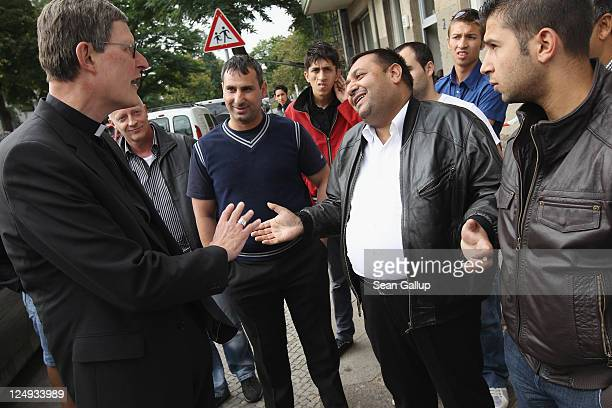 Rainer Maria Woelki Archbishop of Berlin speaks to Roma residents of a building in Harzer Strasse on September 14 2011 in Berlin Germany A...