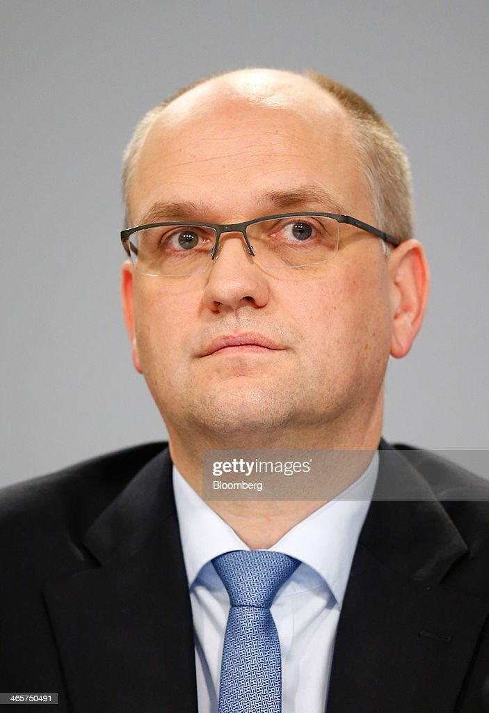 Rainer Neske, member of the board of Deutsche Bank AG pauses during a news conference to announce the bank's results at their headquarters in Frankfurt, Germany, on Wednesday, Jan. 29, 2014. Deutsche Bank AG, Germany's biggest bank, cut total compensation for employees at its investment bank 23 percent in the fourth quarter as a slide in revenue contributed to a loss for the period. Photographer: Ralph Orlowski/Bloomberg via Getty Images
