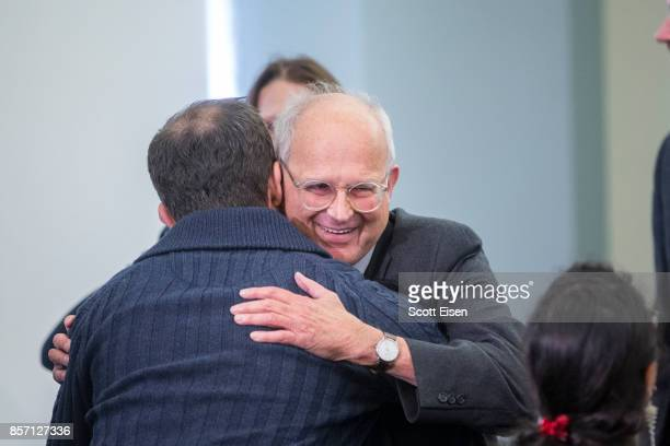 Rainer Weiss professor emeritus of physics at MIT is congratulated after it was announced he shares a Nobel Prize In Physics For LIGO Detector work...