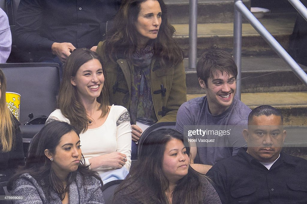 <a gi-track='captionPersonalityLinkClicked' href=/galleries/search?phrase=Rainey+Qualley&family=editorial&specificpeople=3122592 ng-click='$event.stopPropagation()'>Rainey Qualley</a> (L) and <a gi-track='captionPersonalityLinkClicked' href=/galleries/search?phrase=Steven+R.+McQueen+-+Born+1988&family=editorial&specificpeople=4069204 ng-click='$event.stopPropagation()'>Steven R. McQueen</a> attend a hockey game between the Carolina Hurricanes and the Los Angeles Kings at Staples Center on March 1, 2014 in Los Angeles, California.