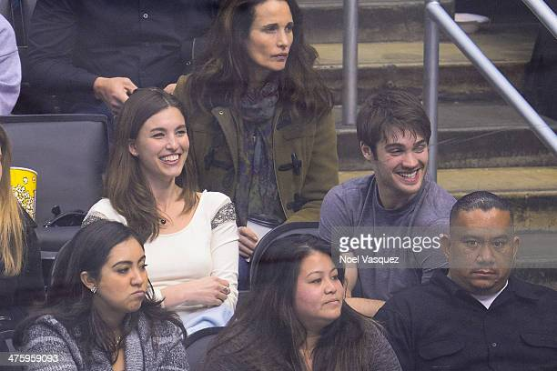 Rainey Qualley and Steven R McQueen attend a hockey game between the Carolina Hurricanes and the Los Angeles Kings at Staples Center on March 1 2014...