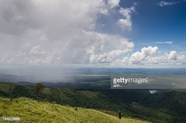 Rainfall can be seen from a viewpoint of the Geodesic Center of South America in Chapada dos Guimaraes Mato Grosso state western Brazil on January 30...