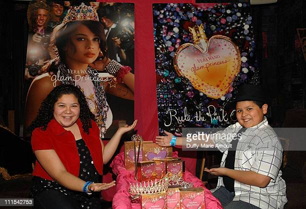 Raini Rodriguez and actor Rico Rodriguez pose with Vera Wang Glam Princess at the Hollywood Helping Haiti Golden Globes Celebrity Charity Lounge at...