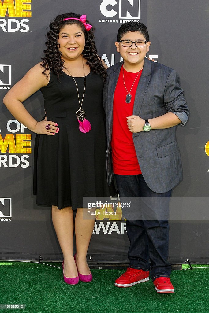 Raini Rodriguez (L) and Rico Rodriguez arrive at the 3rd Annual Cartoon Network's 'Hall Of Game' Awards held at Barker Hangar on February 9, 2013 in Santa Monica, California.