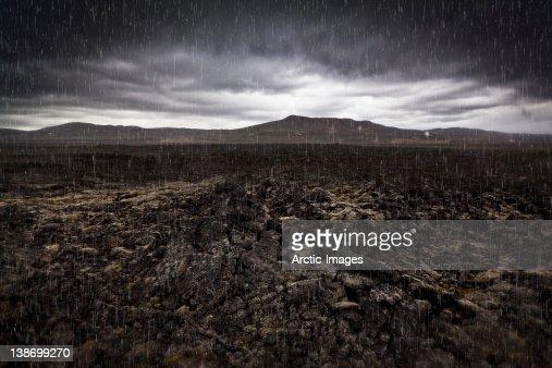 Raining on lava-geothermal region : Stock Photo