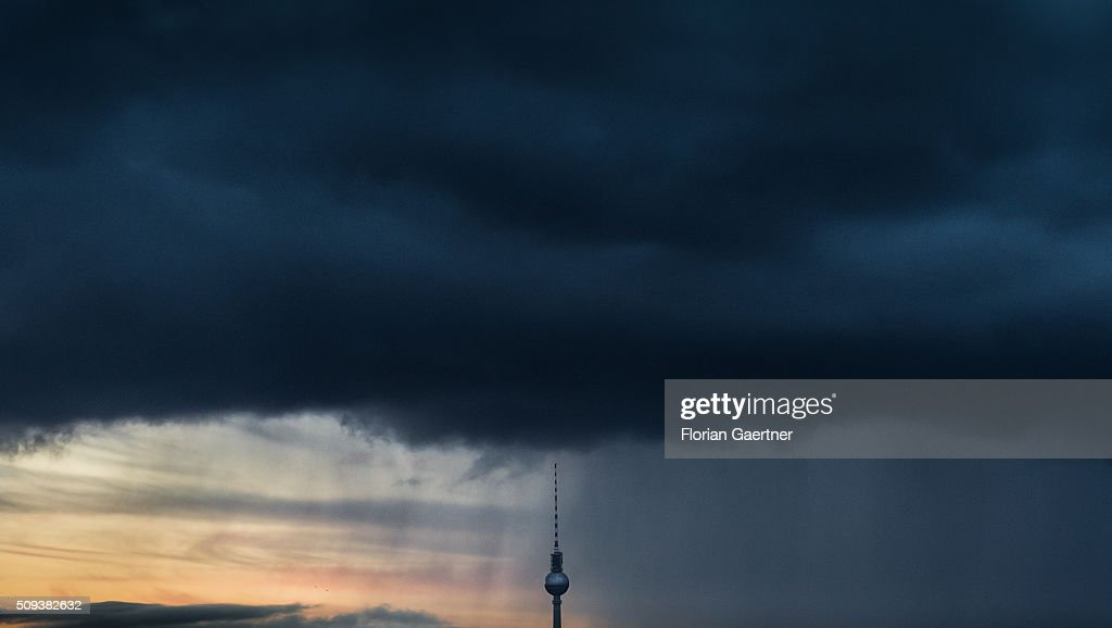 A rainstorm pulls across the Berlin TV Tower on February 10, 2016 in Berlin.