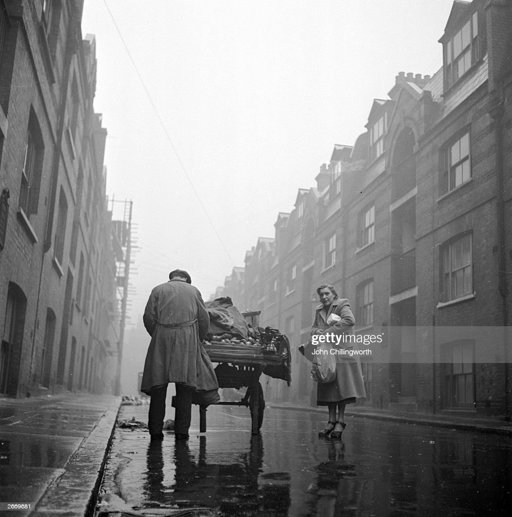 A rainy day in a street in Whitechapel centre of the Jewish community in the East End of London Original Publication Picture Post 5829 Passover Story...
