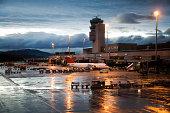 Rainy Evening at Airport Terminal and Hangar