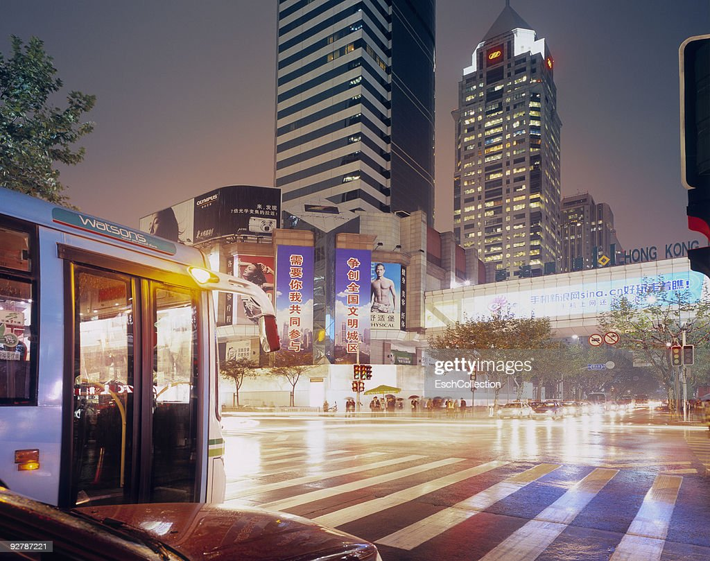 Rainy evening at the shopping district of Shanghai : Stock Photo