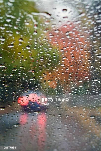Rainy road through the windshild
