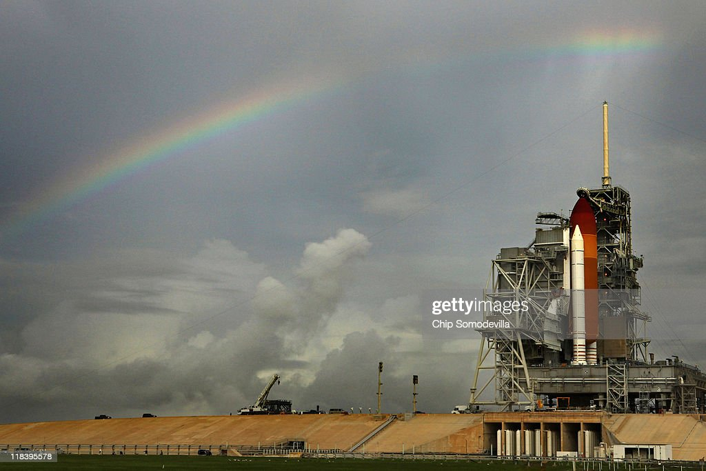 Rainy skies produce a rainbow over the space shuttle Atlantis as it stands on launch pad 39A one day before its scheduled launch at Kennedy Space Center July 7, 2011 in Cape Canaveral, Florida. Atlantis' launch will mark the final liftoff in the 30-year-old space shuttle program.