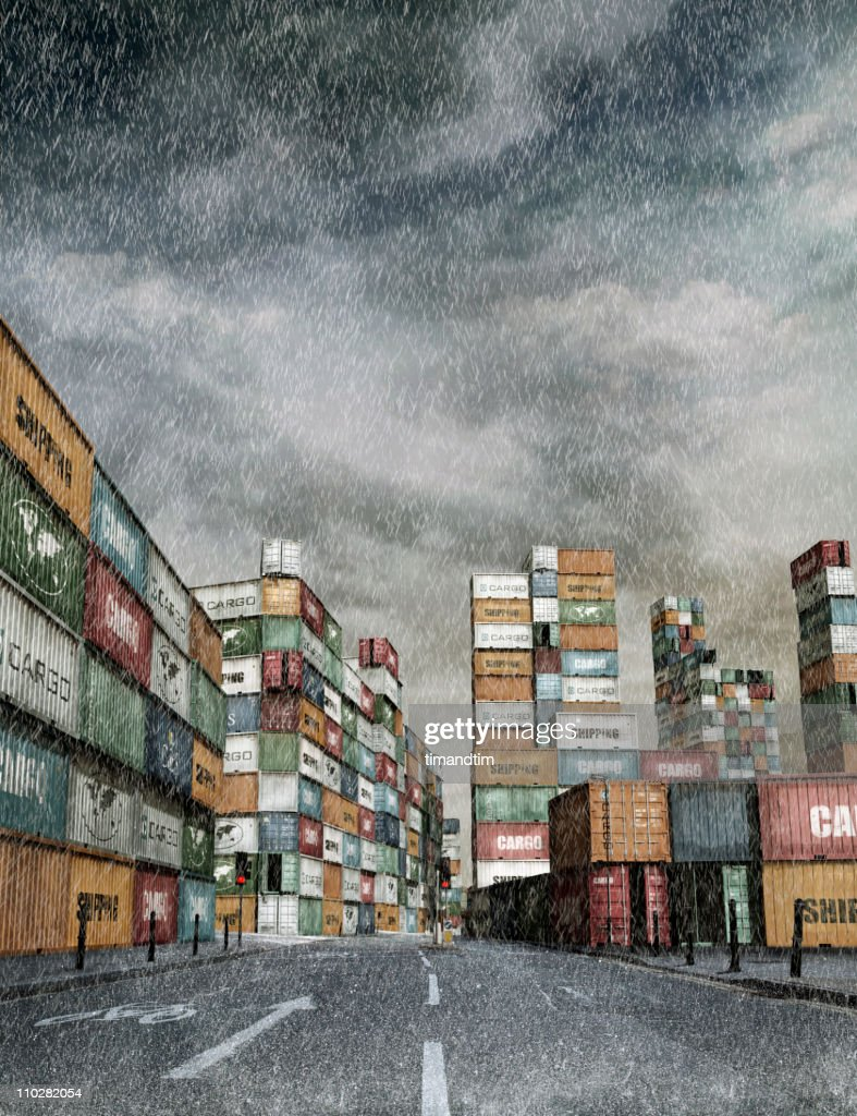 Rainy street in a city of cargo containers : Stock Photo