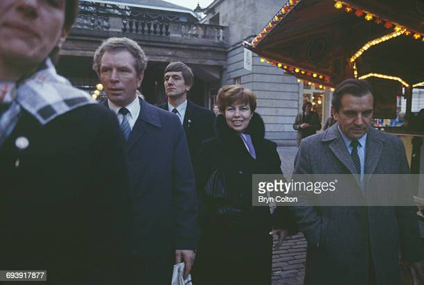 Raisa Gorbachev dressed in a brown fur coat and wife of Mikhail Gorbachev Russian Politburo member and second in line at the Kremlin centre walks...