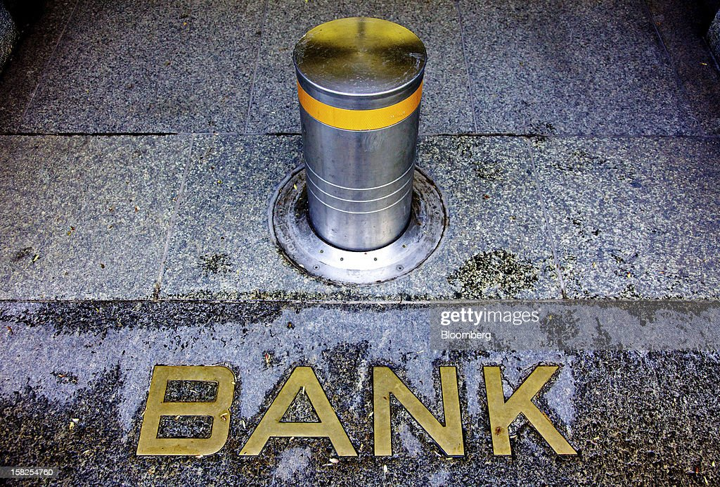 'BEST PHOTOS OF 2012' (): A raised bollard sits behind a 'Bank' sign in Zurich, Switzerland, on Tuesday, April 24, 2012. UBS AG and Barclays Plc are set to sell about $1.3 billion of commercial-mortgage bonds with relative yields at the widest since January as investors push back against risky assets. Photographer: Gianluca Colla/Bloomberg via Getty Images
