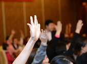 Raised hands in class of university