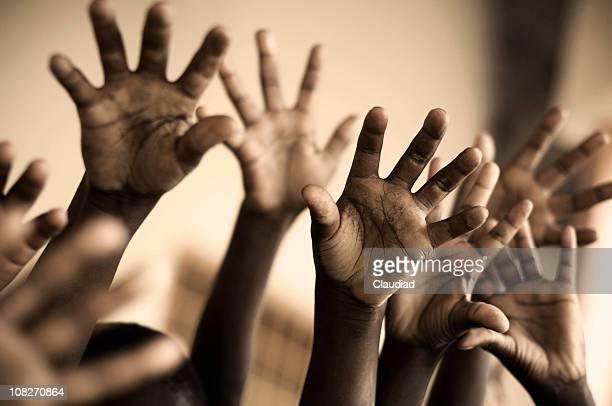 Raised Hands of African School Children