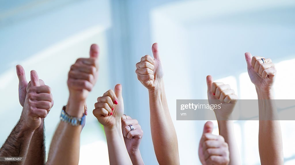 Raised hands with thumbs up