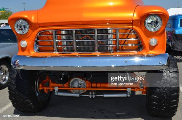 Raised special suspension and huge off road tires are featured on the 1955 Chevy pickup at the Hot August Nights Custom Car Show the largest...