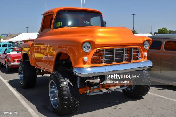 Raised suspension and huge off road tires are featured on the 1955 Chevy pickup at the Hot August Nights Custom Car Show the largest nostalgic car...