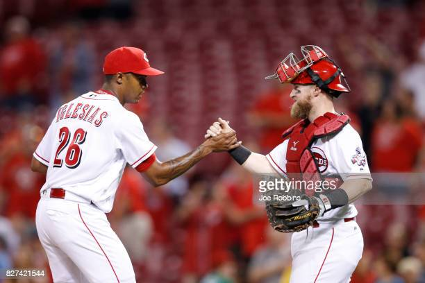 Raisel Iglesias and Tucker Barnhart of the Cincinnati Reds celebrate after the final out in the ninth inning of a game against the San Diego Padres...