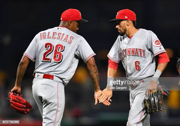 Raisel Iglesias celebrates with Billy Hamilton of the Cincinnati Reds after a 52 win over the Pittsburgh Pirates at PNC Park on August 2 2017 in...
