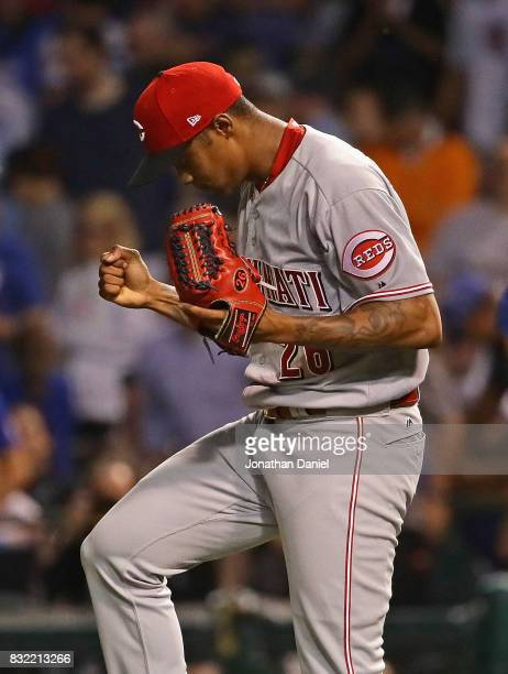 Raisel Iglesias of the Cincinnati Reds celebrates after getting a save in the 9th inning against the Chicago Cubs at Wrigley Field on August 15 2017...