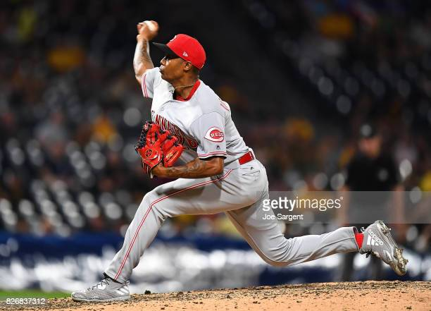 Raisel Iglesias of the Cincinnati Reds in action during the game against the Pittsburgh Pirates at PNC Park on August 2 2017 in Pittsburgh...