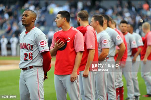 Raisel Iglesias of the Cincinnati Reds looks on during the national anthem ahead of the game against the New York Yankees at Yankee Stadium on...