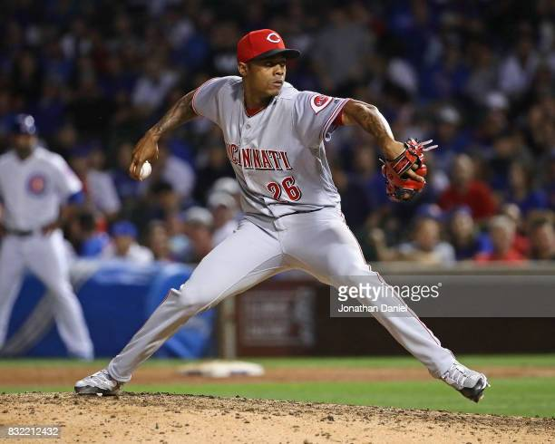 Raisel Iglesias of the Cincinnati Reds pitches in the 9th inning for a save against the Chicago Cubs at Wrigley Field on August 15 2017 in Chicago...